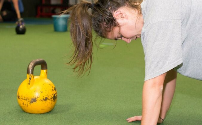 Kettlebells and push ups will make any girl sweat.