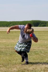 Zach Riley throws the stone June 18 in the Gaylord (Michigan) Highland Games and Air Show. Submitted